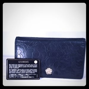 CHANEL Bags - Chanel camellia black bifold wallet